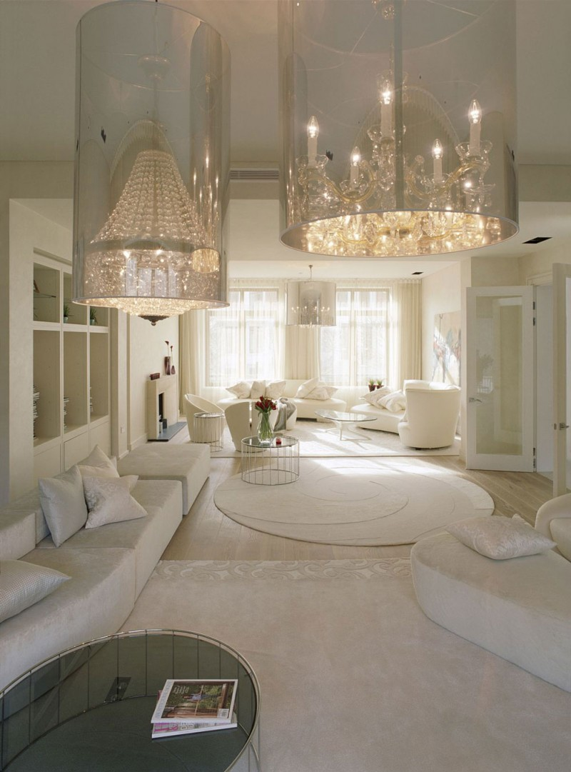 An Extraordinary Weekend Getaway at the Kensington House : 2 Chandeliers White Fur Rug White Round Fur Rug 2 White Round Sofas White Cushions