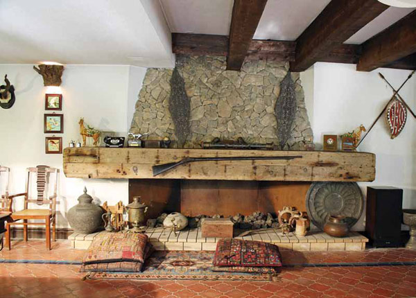 Awesome Stone Fireplace Design For Cozy Living Room : Cool Old Style Stone Fireplace Design With Solid Wood Shell Above With Unique Shape Tile Flooring And Exposed Wooden Beams Ceiling Ideas