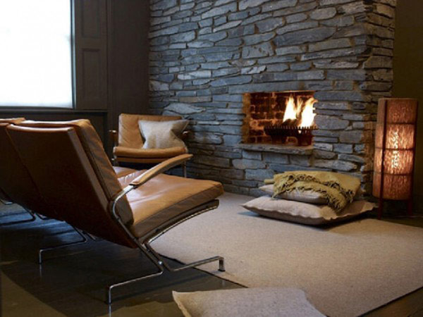 Awesome Stone Fireplace Design For Cozy Living Room: Cool Stone Fireplace Design With Modern Brown Leather Armchair And Big Cushion On Area Rug