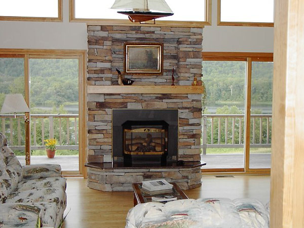 Awesome Stone Fireplace Design For Cozy Living Room : Cozy Delight Sleek Family Room Design With Cool Modern Stone Fireplace Beetwen Lake View Large Glass Sliding Door And Outside Railing Ideas
