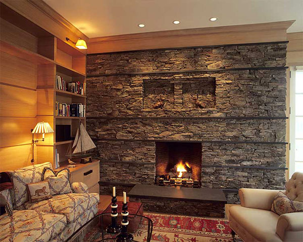 Awesome Stone Fireplace Design For Cozy Living Room : Cozy Family Room Interior Design With Stone Fireplace As A Part Of Stone Wall And Custom High End Bookshelves And Interesting Wall Mounted Lamps