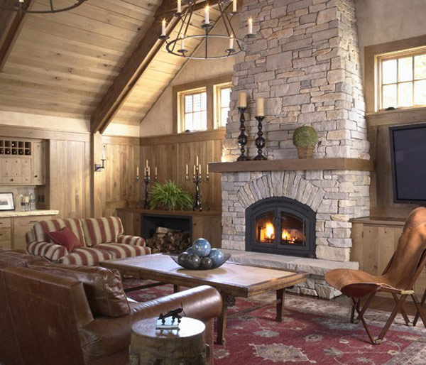 Awesome Stone Fireplace Design For Cozy Living Room : Cozy Rustic Living Room Design With Wooden Sloping Ceiling And Stunning Stone Fireplace And Unique Candle Pendant Light With Sofa On Parsian Area Rug
