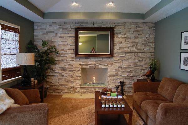 Awesome Stone Fireplace Design For Cozy Living Room: Cozy Small Living Room With Cool Modern Gas Stone Fireplace Design As A Part Of Stone Wall Decoration And Wooden Framed Mirror ~ stevenwardhair.com Fireplace Inspiration