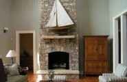 Awesome Stone Fireplace Design For Cozy Living Room : Cozy Tall Ceiling Family Room Design With Tall Stone Fireplace Wooden Wall With Antique Cabinet And Sailboat Decoration Ideas