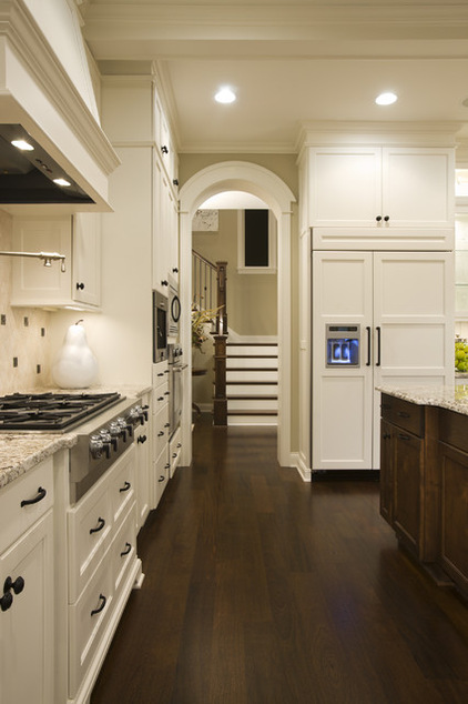 The Right Way Choosing A White Paint For Home : Ivory White Paint At Traditional Kitchen Slight Ivory Undertone Wood Flooring And Clear Halogen Lighting