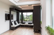 Functional And Multipurpose Apartment Designed : Adorable Tiny But Functional Apartment For Two Students Custom Black Living Room Chair That Can Be Easily Moved With Black Cabinet Bright View And Laminated Floor Design