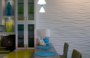 Various Textured Wall At Home Design : Amazing Stainless Steel Glossy Dining Table With Green Chairs At Contemporary Kitchen Plus Pendant Lamp And White Wavy Textures For Walls