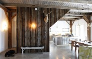 Decorating Tricks to Make A New House Cozy and Welcoming : Amazing Texture Rustic House Inerior Design With Wooden Beams Ceiling And Wall With Kitchen Cabinet And Dining Table Set With Pendant Lights Dog And Concrete Flooring Ideas