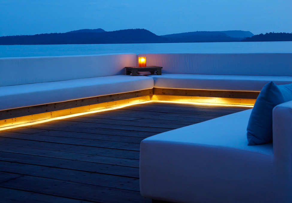 Song Saa : Private Remote Island Resorts In Cambodia : Amazing View At Dusk At Song Saa Private Remote Island Over Water Vista Bar With Long Sofa Lighting And Wooden Flooring Ideas