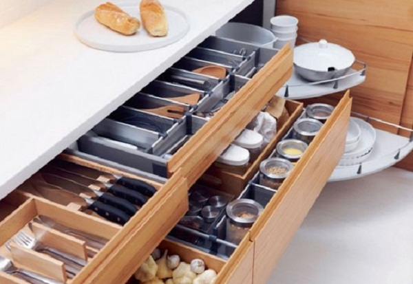 Suitable Kitchen Storage Design For Your Beautiful Kitchen: Amazing White Countertop Wooden COunters With Outstanding Laminated Wooden Drawer Design And Sharp Knives Glass Jars
