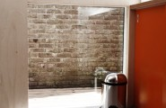 Home Office Inspiring Ideas : Office In Contemporary Garden Pavilion : An Existing Brick Wall As A Wall Decor Of Garden Pavilion Office Or Guest House