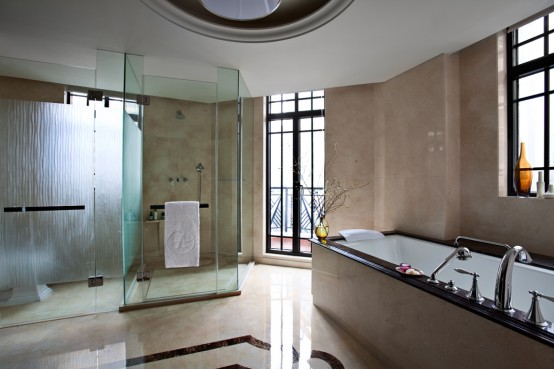 Art Deco Bathroom Designs To Inspire Your Relaxing Sanctuary: Art Decor Spacious Clear Glass Partition Ample Shower Luxurious Tub Large Window Sunny Bright Cream Color Marble Wall And Floor Bathroom Design