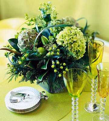 Gorgeous Holiday Table Arrangements: Artichokes Hydrangeas Lily Buds Magnolia Leaves And Greenery In Ceramic Container Monochromatic Look Nontraditional Hue Lime Green Gorgeous Holiday Table Arrangements Green Living