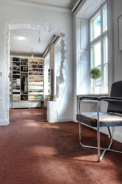 Original Scandinavian Apartment's Interior With Play Of Materials And Colors : Artistic Modern Unfinished Brick Look Doorway White Pallette Simple Green Plant By The Window As Decoration Neat Organized Book Shelves Sunny Bright