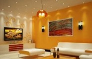 Cotemporary Picture Perfect Living Room Design for City Living : Astonishing Living Room Design For City Living With Yellow Wall Ornamented Wall Decoration Comfortable Living Room Ideas With Nice Painting