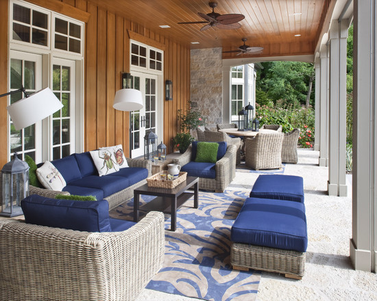 Very Cool Round Wicker Ottoman: Astonishing Traditional Porch Round Wicker Ottoman Deep Blue Cushions Light Grey Wicker Blue Grey Area Rug Board And Batten Siding Accent French Doors To Outdoor Living Area