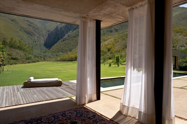 The Swellendam House: Sustainable Contemporary Home In South Africa: Astounding Contemporary Residence Pavilion Exterior Design With Area Rug Curtain Pool Sun Bath Deck Lounge Concrete Flooring And Surrounding By Magnificent Natural Landscape Ideas