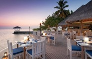 Breathtaking Beauty Remote Islands Resort: Four Seasons Resort Maldives : Astounding Sea Side Outdoor Restaurant Design In Maldives Remote Island Resort With Dining Table Set On Wooden Flooring And Torch Ideas