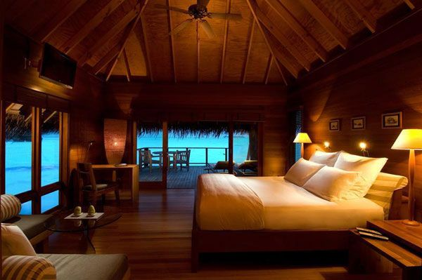 Inspiring Ocean View Bedroom Design Ideas: Astounding Wood Villa Resort Ocean View Bedroom Interior Ideas With King Bed Lamps Chair Table Ceiling Fan Large Window Large Glass Sliding Door With Terrace Exterior Design Ideas