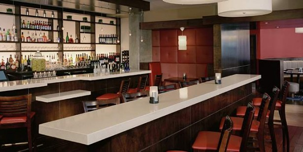 Awesome Bar Design With Cloud White Dupont Bartops And Chairs Padded Wall Bottle Shelves Pendant Lamps Ideas
