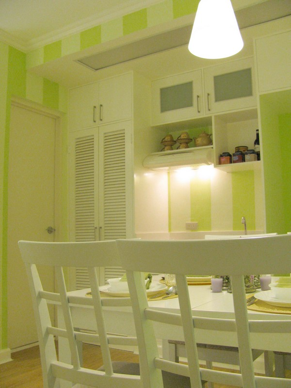 Clever Interior Design Of Lovely Twin 20 sqm Apartment: Awesome Minty Cool Stripe Wall Dining Space Of Wood Floor 20 Sqm Studio Apartment Decoration With White Wooden Painted Furniture And Louvered Cabinet Door With Lighting Ideas