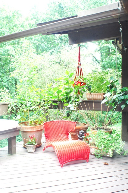Motivational Pictures To Inspire You To Design Your Home Deck: Awesome Outdoor Deck Design Quiet Nook With Funky Brigt Red Rattan Recliner On A Charming Quiet Porch Surrounded By Green Potted Plants