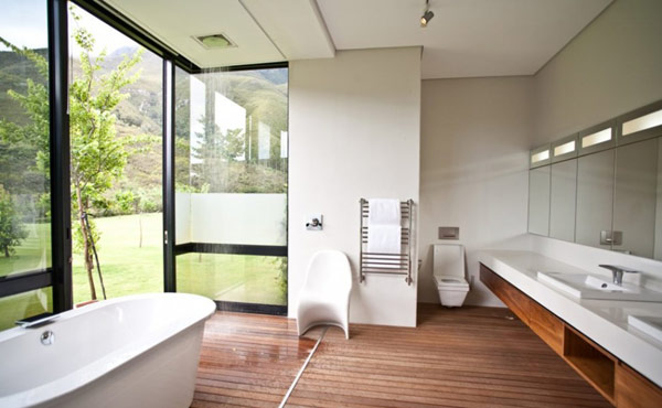The Swellendam House: Sustainable Contemporary Home In South Africa: Beautiful Bathroom Design Interior With Cabinet Mirror Toilet Towel Hanger Chair Bathtub Open Space Rain Shower Window Glass Sliding Door Wooden Flooring And Natural Landscape View