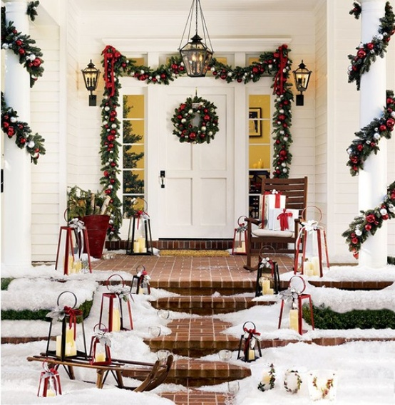 Front Porch Christmas Decorating Ideas: Beautiful Front Porch Christmas Decor Idea With Xmas Wreath Hung On White Wooden Front Door And Pine Garland Around Pillars With Festive Red Bows And Classic Pendant Light And Rocking Chair