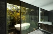 Enchanting Modern Bathroom Design Ideas : Beautiful Garden View Modern Bathroom Design With Outdoor Bathtub Idea And Window Door Mosaic Tile Wall Cabinet Mirror Glass Wall And Wooden Flooring
