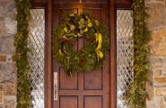 Front Porch Christmas Decorating Ideas : Beautiful Green Christmas Wreath Hung On Front Porch Wooden Door With Classic Pendant Light And Slate Tile Wall Exterior Design Ideas