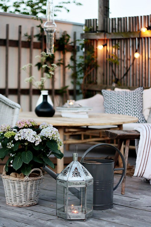 Motivational Pictures To Inspire You To Design Your Home Deck : Beautiful Romantic Outdoor Deck Design With Luch Pastel Blooms And Chic Alumunium Candle Holder Cozy Seating Area