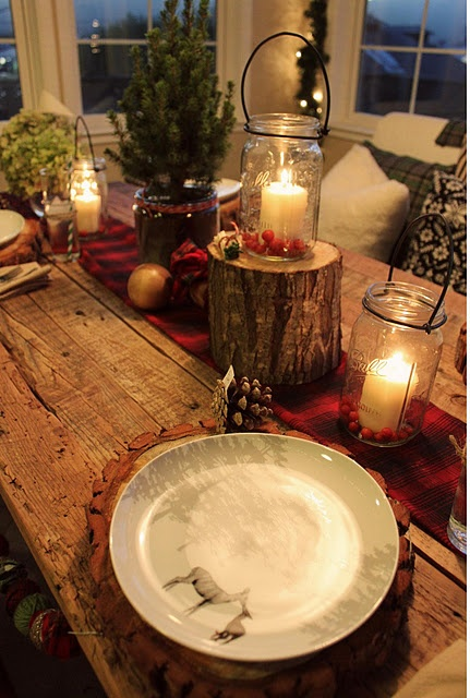 Traditional Collection Vintage Christmas idea: Beautiful Rustic Christmas Table Setting Tree Stumps As Placemats And Center Piece White Candles And Red Berries Inside Used Clear Glass Jars With Black Handles Pine Cones Simple