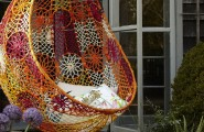 Unbelievably Relaxing Piece Of Furniture Hanging Chair : Beautiful Stunning Outdoor Hanging Chair Bohemian Feel Made Of Colorful Pattern Mesh With Simple Soft White Throw Pillows