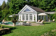 Buying A House With A Pool : Beautiful Traditional House With Pool Umbrellas Seats Flowers Lawn Surrounded By Tree Ideas