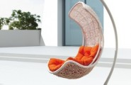 Unbelievably Relaxing Piece Of Furniture Hanging Chair : Beautiful Trendy Stylist Modern Outdoor Hanging Chair Curve Shaped Made Of Painted White Rattan With Bright Plain Orange Cushion