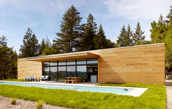 Westside Road House: Mesmerizing Eco Friendly House in The Forest: Beautiful Westside Road Home Exterior Design Facade With Wooden Wall Ideas And Large Glass Sliding Door Terrace Table Bench Armchairs Pool Lawn Surrounding And Forest At Backhome Ideas