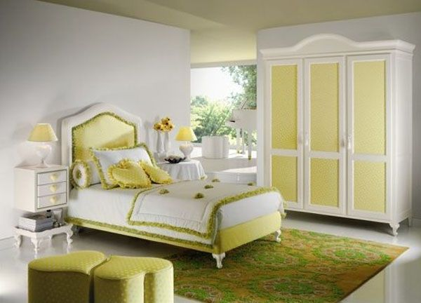 Modern Bedroom Decoration For Teenage Girls Ideas: Beautiful Yellow Scheme Teenage Girls Bedroom Interior Design With Heart Theme Pouf And Cushion With Bedside Table Lamps And Chest Of Drawer With Closet And Floral Rug Ideas