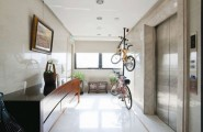Sleek Modern Living Room White Minimal Apartment : Bicycle Hanging Wall Modern Living Room With Elegant Marble Floor Design And Painting Lift Tabletop Hidden Lamps Concentrate Floor