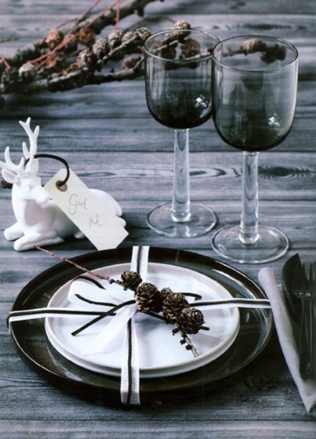 Traditional Collection Vintage Christmas idea: Black And White Theme Winter Rustic Christmas Table Setting Small White Ceramic Of Sitting Raindeer Black Hue Crystal Wine Glass Tiny Pine Cones On A Branch As Plate Decoration