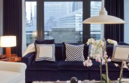 Extraordinary Fur Area Rug At Home : Blue Ambiance Modern Living Room With Blue Sofa And Cushion Plus Comfortable White Arm Chair At Furry Area Rugs And Natural Wood Table