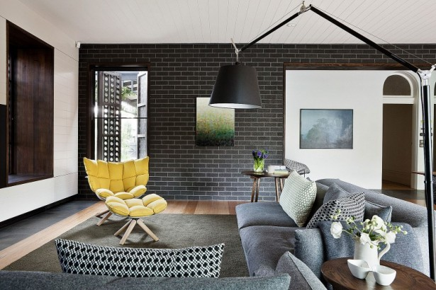 Small Modern and Minimalist Houses In Australia: Breathtaking Brick Black Wall Decoration With Wooden Floor Design And Yellow Chair Grey Rug Nice Lamp ~ stevenwardhair.com Architecture Inspiration