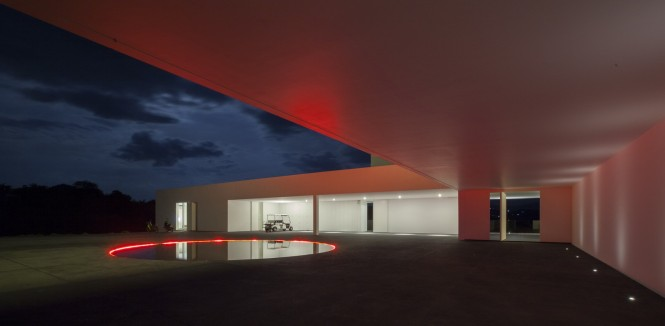 Great Houses with Remarkable Landscape and Contour : Breathtaking Round Pool Red Lights White Ceiling Design Ideas
