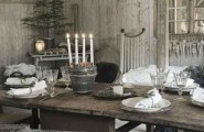 Festive Christmas Decorations For An Adult : Breathtaking Rustic Christmas Table Setting Tree Stumps As Placemats And Center Piece White Candles And Red Berries Inside Used Clear Glass Jars And Old Cripy Pendant