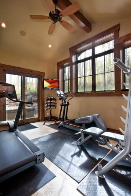 Inspiring Strategically Placed Gym In A Stylist Living Room: Bright And Well Air Circulated Space For Your Home Gym Design Ideas With Large Windows And Door And Ceiling Fan