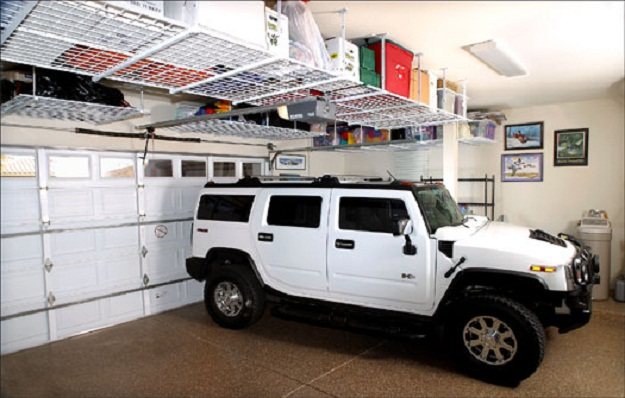 Ideas To Create An Organized And Modern Looking Garage: Brown Floor White Off Road Car Red Box Garage Storage Systems With White Hang Rack Nice Brown Color Tiles Floor