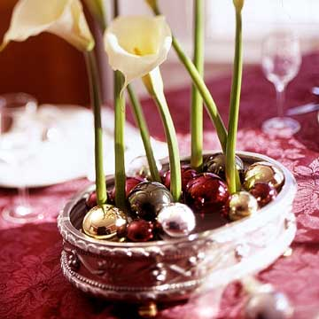 Gorgeous Holiday Table Arrangements: Calla Lilies And Small Ball Ornaments On Oval Silver Container Awesome Holiday Table Arrangements Floral Shine