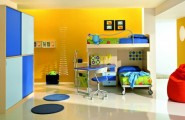 Ergonomic toys and clothes Storage For Kids Room : Captivating Luxury Kids Bedroom With A Lot Of Space Storage And Comfortable Working Place Decortion With Yellow Painted Wall With Picture Wall And Sliding Bed And Study Desk