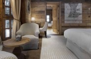Breathtaking Cozy Resort For Your Family Holiday : Carpet White Bed Wooden Wall Curtains Wooden Door