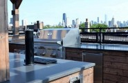 Awesome Outdoor Kitchen Designs That Will Make Your Patio Stylish And Inviting : Casual Outdoor Kitchen Designs Ideas With Marble Top Curved Outdoor Kitchens Complete With Kitchen Appliance Stove Mini Bar Opened Exposed Wooden Ceiling