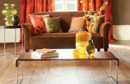 Cool Bright And Colorful Living Room : Chocolate And Orange Living Room With Wood Patterned Marble Floor With A Couch In Front Of A Simple Wooden Table With A Small Round Table Next To Them With A Decorative Vase S